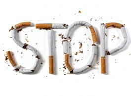Stop smoking word written with broken cigarette concept for quitting smoking